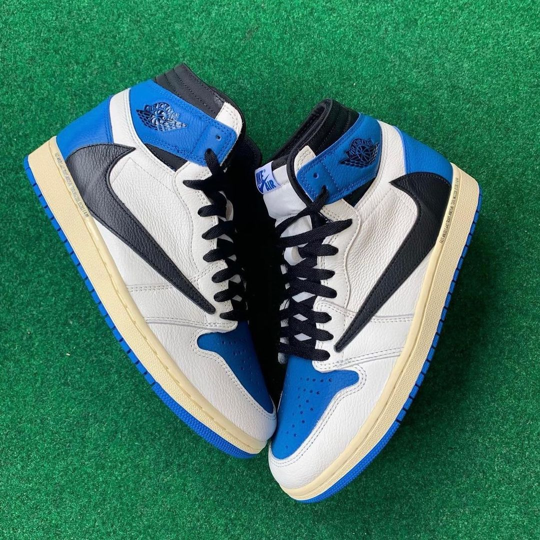 This is a pair of Jordan 1. This exclusive sneakers are a collab between the artist Travis Scott and Fragment. The sneakers are off-white, black and blue and feature and reverse swoosh.